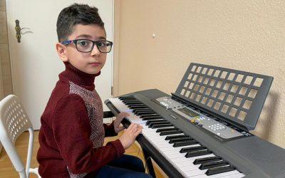 Klavier–Unterricht für Armen